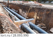 Купить «Repair work of heating duct. Replacement pipes of the heating main in summertime», фото № 28093990, снято 8 октября 2017 г. (c) FotograFF / Фотобанк Лори