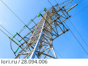 Купить «High voltage electric tower against the blue sky. Power transmission line», фото № 28094006, снято 8 октября 2017 г. (c) FotograFF / Фотобанк Лори