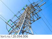 Купить «High voltage electric tower against the blue sky. Power transmission line», фото № 28094006, снято 8 октября 2017 г. (c) FotograFF / Фотобанк Лори