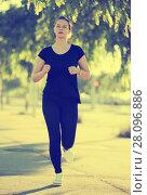 Купить «Girl jogging during outdoor workout», фото № 28096886, снято 5 июля 2017 г. (c) Яков Филимонов / Фотобанк Лори