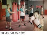 Купить «Portrait of girl boxer in boxing hall», фото № 28097794, снято 12 апреля 2017 г. (c) Яков Филимонов / Фотобанк Лори