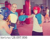Купить «Boxing instructor closely follows the teenagers in sparring», фото № 28097806, снято 12 апреля 2017 г. (c) Яков Филимонов / Фотобанк Лори