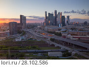 Купить «Third transport ring, railway and skyscrapers at evening during sunset in Moscow, Russia», фото № 28102586, снято 13 июня 2016 г. (c) Losevsky Pavel / Фотобанк Лори