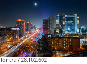 New Arbat Street, highway with moving cars at moony night in Moscow, Russia (2015 год). Стоковое фото, фотограф Losevsky Pavel / Фотобанк Лори