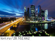 Купить «MOSCOW - MAY 30, 2015: Moscow International Business Center and river at night. Investments in Moscow International Business Center was approximately 12 billion dollars», фото № 28102662, снято 30 мая 2015 г. (c) Losevsky Pavel / Фотобанк Лори