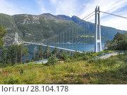 Купить «Hardanger Bridge over the Eidfjorden from above, Norway, Scandinavia, suspension bridge Hardangerbrua, Hardangerfjord between Ullensvang and Ulvik, Hordaland county.», фото № 28104178, снято 1 июля 2017 г. (c) age Fotostock / Фотобанк Лори