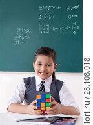 Купить «Girl with Rubik cube in a classroom», фото № 28108018, снято 6 июня 2014 г. (c) easy Fotostock / Фотобанк Лори
