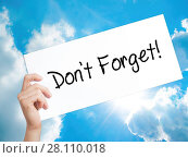 Купить «Don't Forget! Sign on white paper. Man Hand Holding Paper with text. Isolated on sky background», фото № 28110018, снято 13 ноября 2018 г. (c) easy Fotostock / Фотобанк Лори