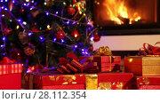 Купить «Closeup of Christmas gifts with fireplace in the background», видеоролик № 28112354, снято 10 января 2015 г. (c) Алексей Кузнецов / Фотобанк Лори