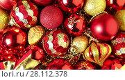 Купить «Full frame video shot of Christmas tree decorations», видеоролик № 28112378, снято 21 ноября 2015 г. (c) Алексей Кузнецов / Фотобанк Лори