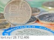 Купить «Рублевые монеты и купюры рядом с логотипом федеральной налоговой службы (крупный план)», фото № 28112406, снято 3 марта 2018 г. (c) E. O. / Фотобанк Лори