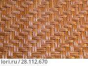 Купить «Узор плетения из прутьев ивы. Фон», фото № 28112670, снято 2 марта 2018 г. (c) Наталья Волкова / Фотобанк Лори