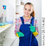 Купить «portrait of young woman cleaning», фото № 28114462, снято 23 мая 2018 г. (c) Яков Филимонов / Фотобанк Лори