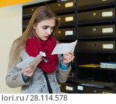 Купить «Young woman in coat receiving ugly news», фото № 28114578, снято 24 июля 2019 г. (c) Яков Филимонов / Фотобанк Лори