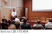 Купить «Public speaker giving talk at business event», видеоролик № 28115454, снято 5 апреля 2020 г. (c) Matej Kastelic / Фотобанк Лори
