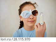 Купить «Closeup face of girl in dark sunglasses with one lens wrapped by piece of fabric and finger in removable plaster cast», фото № 28115970, снято 3 февраля 2017 г. (c) Losevsky Pavel / Фотобанк Лори