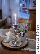 Купить «Burning candle in candlestick on table», фото № 28115986, снято 3 февраля 2017 г. (c) Losevsky Pavel / Фотобанк Лори