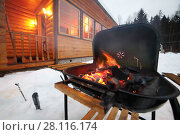 Купить «Barbecue stove with burning coals at winter evening near wooden cottage», фото № 28116174, снято 24 февраля 2017 г. (c) Losevsky Pavel / Фотобанк Лори