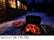 Купить «Barbecue stove with burning coals, meat in bowl at winter night near cottage», фото № 28116182, снято 24 февраля 2017 г. (c) Losevsky Pavel / Фотобанк Лори