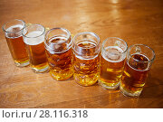 Купить «Six glass mugs of beer on wooden table», фото № 28116318, снято 1 ноября 2016 г. (c) Losevsky Pavel / Фотобанк Лори
