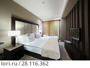 Купить «YEREVAN, ARMENIA - JAN 4, 2017: Bedroom in Hotel National, Created in a business style, the comfortable hotel allows every guest to feel welcome», фото № 28116362, снято 4 января 2017 г. (c) Losevsky Pavel / Фотобанк Лори
