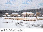Купить «Wooden old-style buildings and logs in Russian Orthodox Monastery at winter day», фото № 28116366, снято 15 ноября 2016 г. (c) Losevsky Pavel / Фотобанк Лори