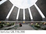 Купить «YEREVAN, ARMENIA - JAN 5, 2017: Flowers are on floor in Memorial complex Tsitsernakaberd, dedicated to genocide of armenians in 1915», фото № 28116390, снято 5 января 2017 г. (c) Losevsky Pavel / Фотобанк Лори