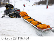 Купить «Snowmobile for transportation injured people at ski resort in mountains», фото № 28116454, снято 6 января 2017 г. (c) Losevsky Pavel / Фотобанк Лори