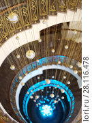 Купить «Beautiful empty spiral staircase with illumination and hanging balls in hotel», фото № 28116478, снято 7 января 2017 г. (c) Losevsky Pavel / Фотобанк Лори