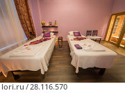 Купить «Empty room with two beds for thai massage and asian decoration», фото № 28116570, снято 12 декабря 2016 г. (c) Losevsky Pavel / Фотобанк Лори