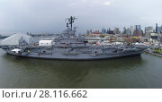Купить «NEW-YORK - SEP 07, 2014: Ship USS Intrepid (CV-11) with Sea-Air-Space museum on pier 86 near city at autumn day. Aerial view. Ship was decommissioned in 1974.», фото № 28116662, снято 7 сентября 2014 г. (c) Losevsky Pavel / Фотобанк Лори