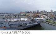 Купить «NEW-YORK - SEP 07, 2014: Sea-Air-Space museum on ship USS Intrepid (CV-11) which moored at pier 86. Aerial view. Museum was founded in 1982.», фото № 28116666, снято 7 сентября 2014 г. (c) Losevsky Pavel / Фотобанк Лори