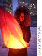 Купить «Woman is holding burning red chinese lantern at winter evening in yard of residential complex», фото № 28116846, снято 14 февраля 2016 г. (c) Losevsky Pavel / Фотобанк Лори