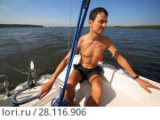 Купить «Man controls boat using tiller at stern during sailing on river at summer day», фото № 28116906, снято 19 августа 2016 г. (c) Losevsky Pavel / Фотобанк Лори