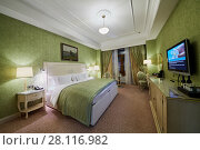 Купить «MOSCOW, RUSSIA - NOV 13, 2015: Interior of double room in hotel Radisson Royal Ukraine, one of the seven Stalin skyscrapers», фото № 28116982, снято 13 ноября 2015 г. (c) Losevsky Pavel / Фотобанк Лори