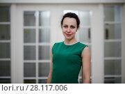 Купить «Portrait of smiling woman in green dress», фото № 28117006, снято 13 ноября 2015 г. (c) Losevsky Pavel / Фотобанк Лори