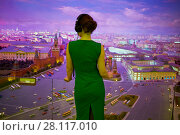 Купить «Woman in green dress with headphone looks at diorama of Moscow, rear view», фото № 28117010, снято 13 ноября 2015 г. (c) Losevsky Pavel / Фотобанк Лори