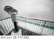 Купить «Binoculars on viewing platform on snowy day and buildings in fog in Moscow», фото № 28117042, снято 20 октября 2016 г. (c) Losevsky Pavel / Фотобанк Лори
