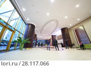 Купить «MOSCOW - OCT 20, 2016: Modern hall in Empire tower in Moscow city business center, Empire Business Complex - 60-story skyscraper built in 2006», фото № 28117066, снято 20 октября 2016 г. (c) Losevsky Pavel / Фотобанк Лори