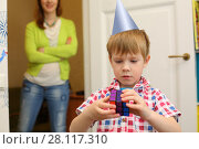 Купить «MOSCOW - MAY 7, 2016: Boy (with MR) plays with Rubik Cube, mother (with MR) out of focus. Over 350 million cubes sold worldwide making it world top-selling puzzle game and the world best-selling toy», фото № 28117310, снято 7 мая 2016 г. (c) Losevsky Pavel / Фотобанк Лори