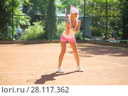 Купить «Girl in cap takes stand with racket on tennis playground outdoor», фото № 28117362, снято 24 июня 2016 г. (c) Losevsky Pavel / Фотобанк Лори