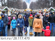 Купить «MOSCOW - MAR 12, 2016: Crowd during Shrovetide in Sokolniki Park», фото № 28117470, снято 12 марта 2016 г. (c) Losevsky Pavel / Фотобанк Лори