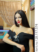 Купить «Pretty young woman in black dress with red lips poses in casino», фото № 28117574, снято 24 октября 2016 г. (c) Losevsky Pavel / Фотобанк Лори