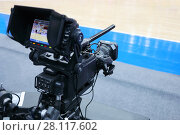 Купить «Professional camera with microphone at basketball game in modern stadium», фото № 28117602, снято 27 января 2017 г. (c) Losevsky Pavel / Фотобанк Лори