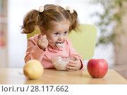 Купить «Child eating yogurt.», фото № 28117662, снято 11 июля 2020 г. (c) Оксана Кузьмина / Фотобанк Лори