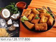 Купить «Coconut Crusted Fish on a plate», фото № 28117806, снято 23 февраля 2018 г. (c) Oksana Zh / Фотобанк Лори