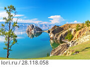 Купить «Baikal Lake. Rocky coast of Olkhon Island and Shamanka Rock - a natural landmark on a sunny June afternoon», фото № 28118058, снято 19 июня 2014 г. (c) Виктория Катьянова / Фотобанк Лори