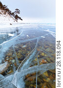 Купить «Baikal Lake in the winter. Through the thick transparent ice the stones on the bottom are visible», фото № 28118094, снято 4 марта 2018 г. (c) Виктория Катьянова / Фотобанк Лори