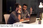 Купить «creative team with computer working late at office», видеоролик № 28118450, снято 29 января 2018 г. (c) Syda Productions / Фотобанк Лори