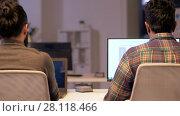 Купить «programmers with computers working late at office», видеоролик № 28118466, снято 29 января 2018 г. (c) Syda Productions / Фотобанк Лори